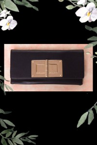 CLUTCH HANDBAG WITH OVERSIZED CLOSURE OnTrend.Eu