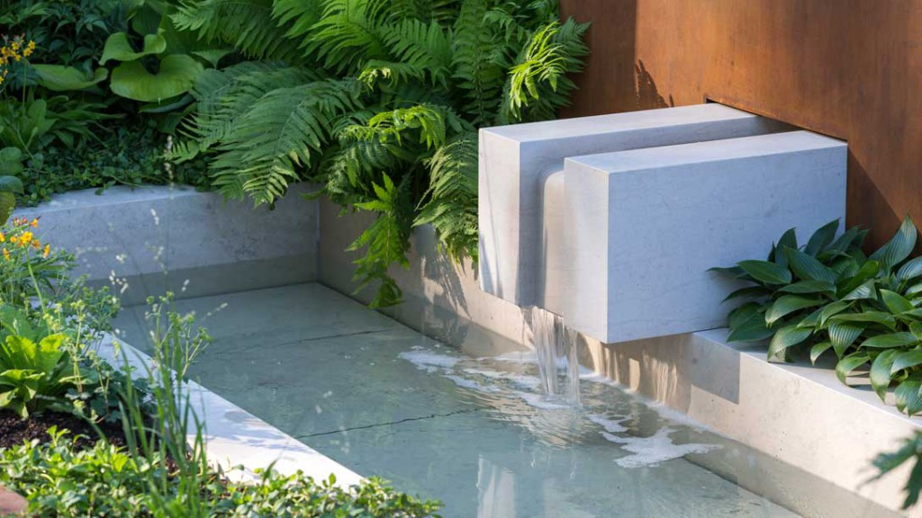Water flows through limestone blocks to create a calming natural sound