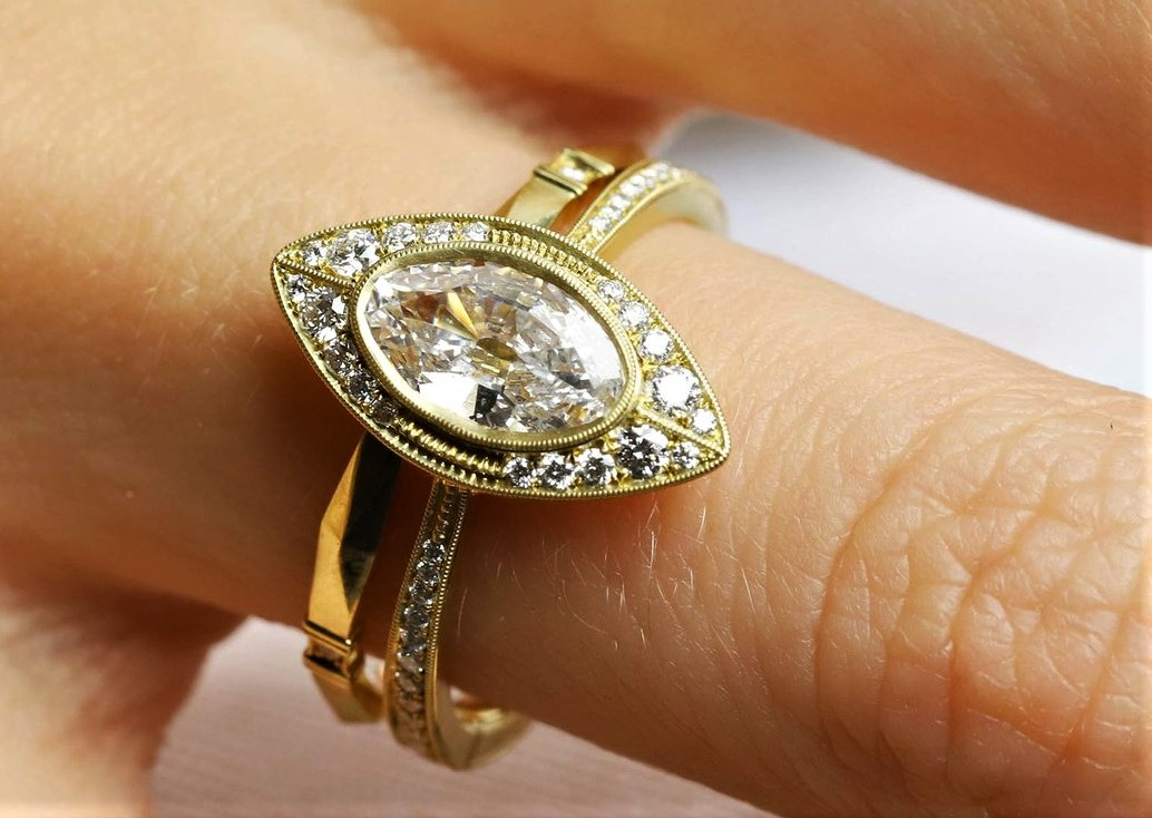 Moval diam ring Greenwich st jewelers on model val day on model.jpg