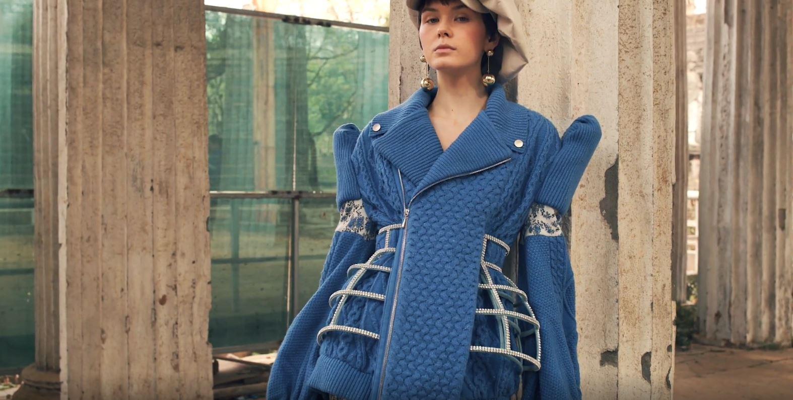 Milan 2 Sara Wong video blue sweater cage.JPG