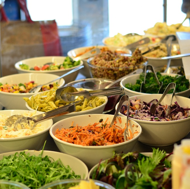 A table full of bowls of food Description automatically generated with medium confidence