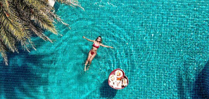 Nirvana Resort 8-21 girl floating in pool.JPG