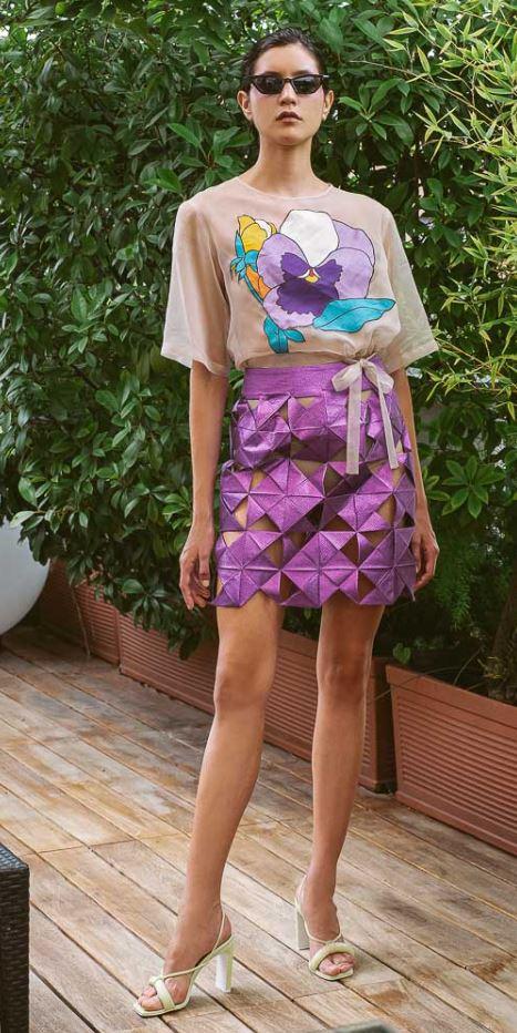 Milan no. 2 emerg Ita Sustainable Gilberto Calzolari purp skirt camera.JPG